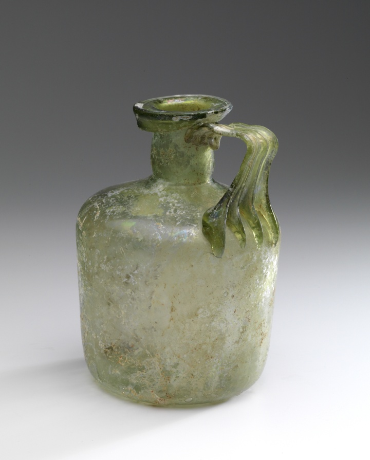 Roman cylindrical glass bottle