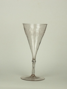 Description: The glass has a straw tint with a pattern-molded conical bowl with a hollow stem on a plain foot.77E Frenchwine
