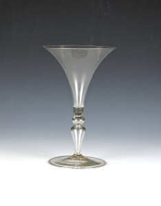 Stem definition: hollow knop and inverted baluster  Description: The glass has a trumpet-shape bowl with a broad mouth a hollow knop and inverted baluster stem on a flat circular foot. 84E FrenchWine